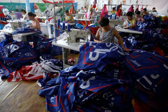 """Workers make flags for U.S. President Donald Trump's """"Keep America Great!"""" 2020 re-election campaign at Jiahao flag factory in Fuyang"""